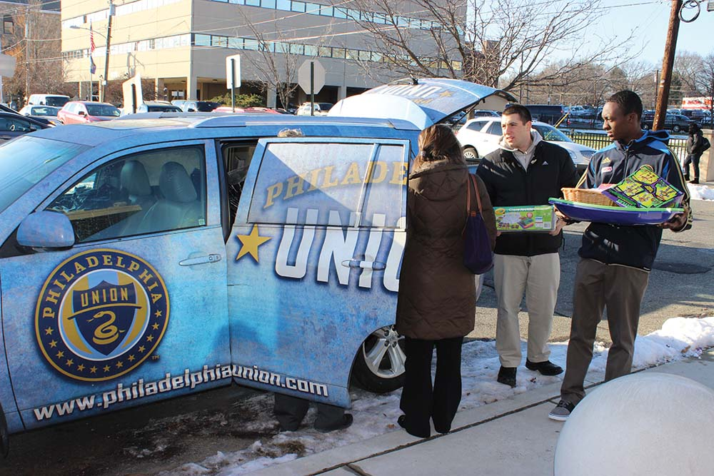 Union staff spread joy through food and toy drives
