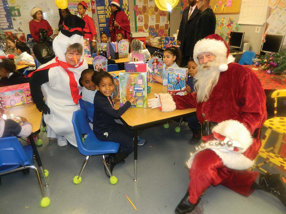 Santa visits charter school with annual gifts for students