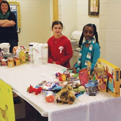 Fourth graders Ally and Nuha helped collect donations for the Chester County SPCA at the Hilltop Elementary Family Fun Fest. Photo by Lauren Gillespie
