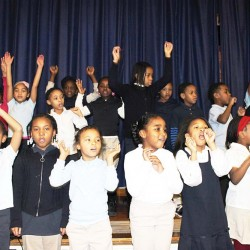 "The first graders from Bell Avenue Elementary sung and danced to ""Mr. King."""