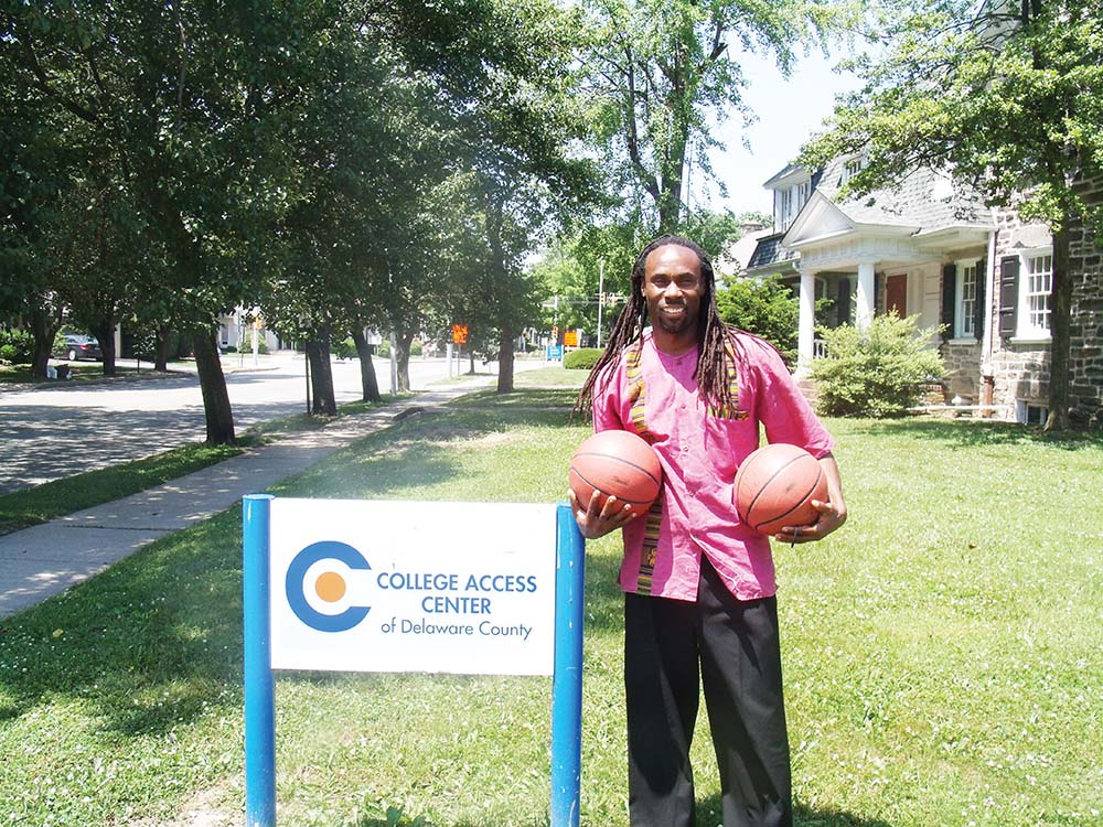 "Julani Ghana in happier times in front of the College Access Center. Now he and others on Harrah's Scholarship Committ are ""heartbroken and disappointed."" Spirit file photo."
