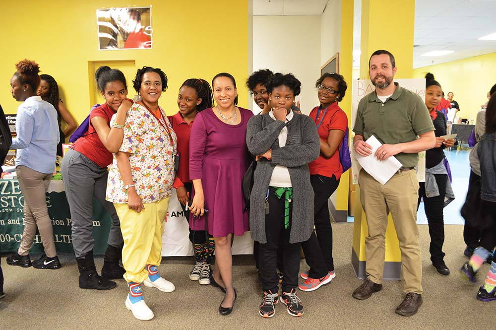CCSA Nurse Denise Dill (second from left) and Principal Akosua Watts (fourth from left) pose with students and staff during the Asthma Awareness Fair