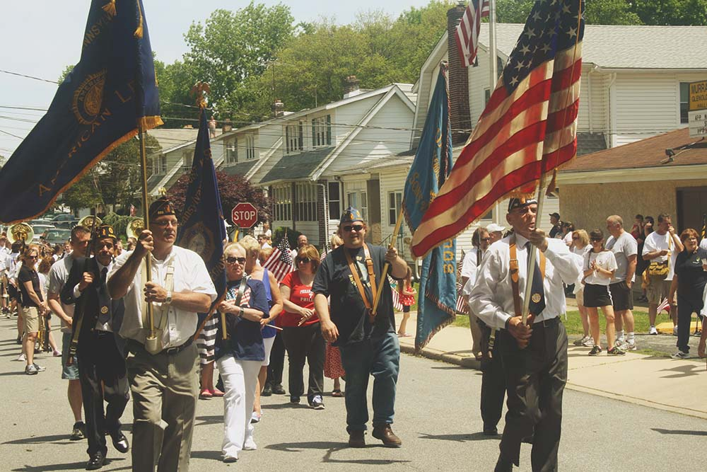 Veterans, students, scouts and residents marched along Glen Ave.