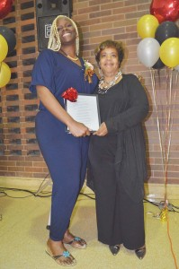 Chester High School PTO President Raushanah Carter (left) accepts congratulations from CHS Principal Constance McAlister after Carter was honored.