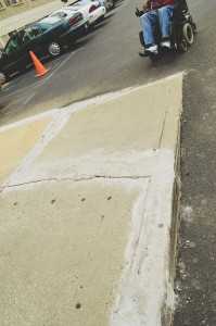 """Tenants insist that Palmerhouse management allows poor quality maintenance and they point to what they call """"a quick and sloppy job"""" patching cracks in the concrete sidewalk that causes problems for tenants in wheelchairs."""