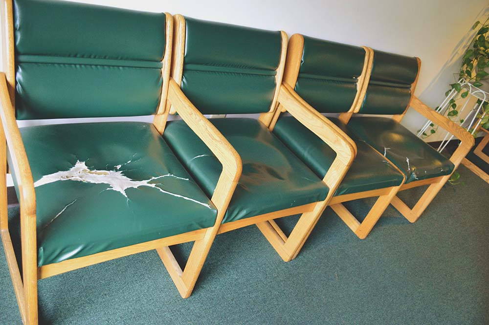 Residents complain that common area furniture is failing in the lounge spaces of the apartment building.