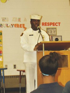 Academy Park High School student Mark Davies, a Navy Seal cadet, sang the National Anthem.