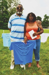 Pete Washington and Sandra Brown stand behind the memorial for Emerson Price, III, their loved one lost to gun violence. Price was Washington's nephew and Brown's son.