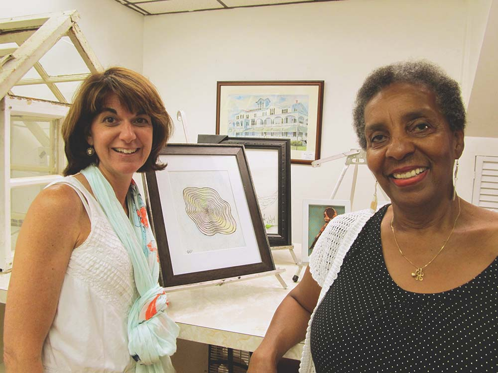 "Aging at Home Director Christine Helmandollar (above, left) enjoyed the work of artist Regina Powell, who showcased her piece, ""Infinity"" at the show."