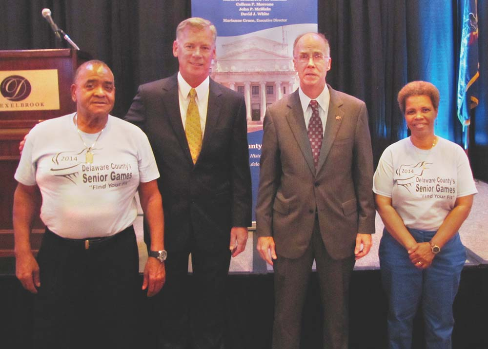 Delaware County Senior Games bowlers George Lampkin (left) and his wife, Linda (right), were congratulated by Delaware County Council Chairman Tom McGarrigle (second from left) and Pennsylvania Secretary of Aging Brian Duke, who attended the Winners' Circle reception in Drexel Hill.
