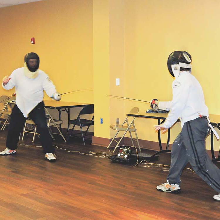 City children learn about fencing at summer camp