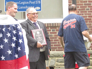 Mayor John Dukes, Jr., is presented with the East Lansdowne Fire Company Public Service Award.