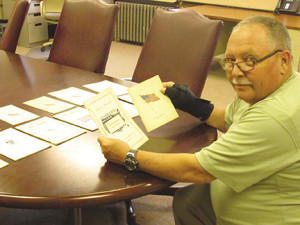 East Lansdowne Mayor John Dukes holds brochures from 1916 and 1917. The brochures spread out are from the years 1916 to 1930. The first parade was in 1915, but Dukes said the brochure from that parade was being redone at the printer.