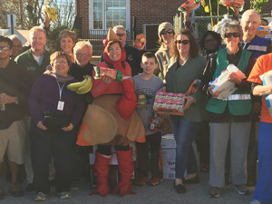 Julie Brown dressed as the turkey this year and stood with volunteers and county officials.