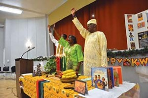 Harambee! The Wright family of Yeadon – (from left) Robert E. Wright, Jr, his mother, Sandra Brown-Wright, and her husband, Robert E. Wright, Sr. - led the celebration of Kwanzaa in the borough last week.