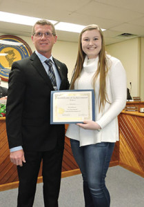 Aston First Ward Commissioner Michael Link presented Sun Valley High School basketball player Kate Lannon with a certificate of achievement in recognition of Lannon's scoring 1,000 points.