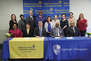 Officials from Cheyney University of Pennsylvania and Delaware County Community College at the signing ceremony Monday for new agreements between the two schools. The ceremony took place at DCCC's Marple Campus.