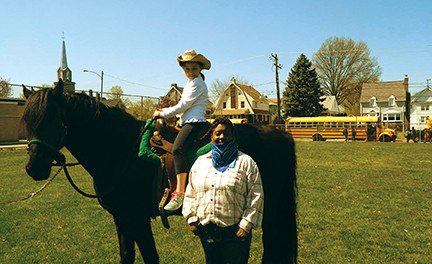 Not horsin' around: 'Cowgirl' principal rides in after students read 250,000 minutes