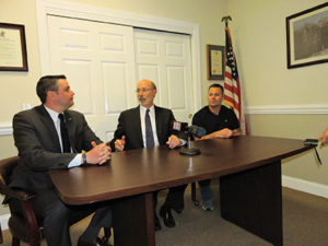 With state Rep. Nick Miccarelli (R-162) and Glenolden resident John Beinlich looking on, Gov. Tom Wolf makes a point during a press conference last week at Miccarelli's Ridley office.