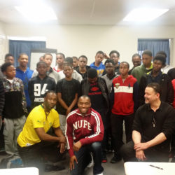The boys of the  College Access Center of Delaware County's Male Achievers with director Julani Ghana and CNN commentator Dr. Marc Lamont Hill.