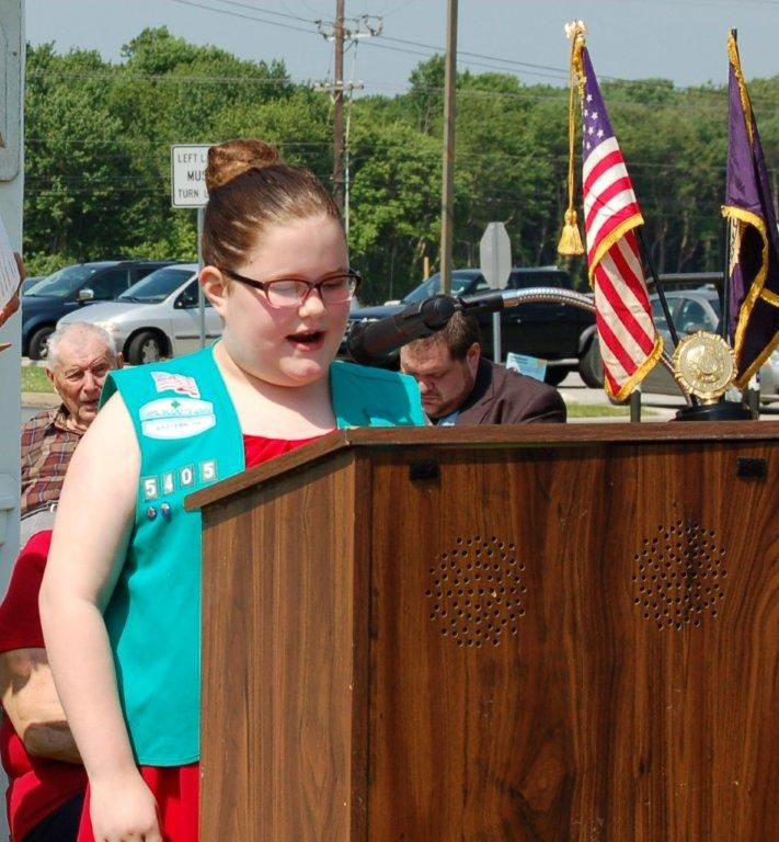 "Girl Scout Sophia Coleman reciting ""In Flanders Fields"" at the Brookhaven Memorial Day event."