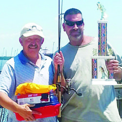 Joe Flynn with derby winner Mike Roche, who pulled in a 22.5 inch catfish.
