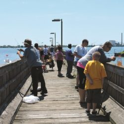 Participants enjoying the Father's Day Fishing Derby in Marcus Hook.