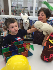 Toys, puzzles and books galore were all in place for Nether Providence resident Donna McCole and her grandson, Finn Hoenke, 4, as the Media-Upper Providence Library had a soft opening last week.