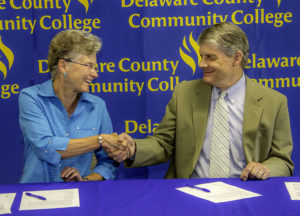 Dr. Kristin Woolever, Penn State Brandywine chancellor, and Dr. Jerry Parker, president of Delaware County Community College, at the signing ceremony held at DCCC's Marple Campus.