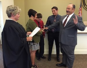 Magisterial District Justice Wendy Roberts (left) administered the oath of office to newly-appointed Concord Supervisor Thomas Mahoney (right) as his wife, Christina, (second from left) held the Bible and their sons, Nicholas (center) and Thomas, (second from right) participated.