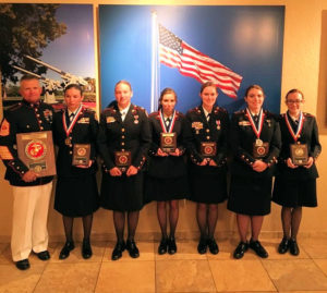 Master Gunnery Sergeant James Pearn poses with Sun Valley High School JRROTC cadets Stephanie Farnsworth, Angela Sauter-Faga, Shelby Jackson, Elizabeth Luoma, Cassie Morris, and Elaina Reynolds. The team captured the National High School Physical Fitness Championship for the second consecutive year. Photo courtesy of the Penn-Delco School District