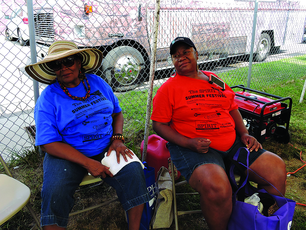 Collingdale residents Rayette Boyer (left) and her daughter, Carlene Hamilton, found shade under a tent in the vendors' pavilion.