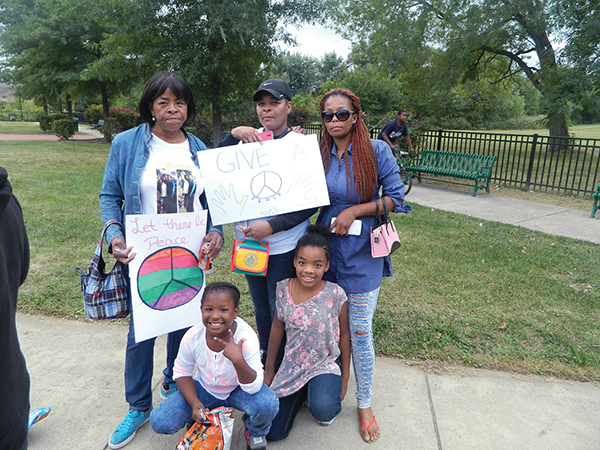 Women of the Powell family came to Memorial Park to fight for an end to violence.