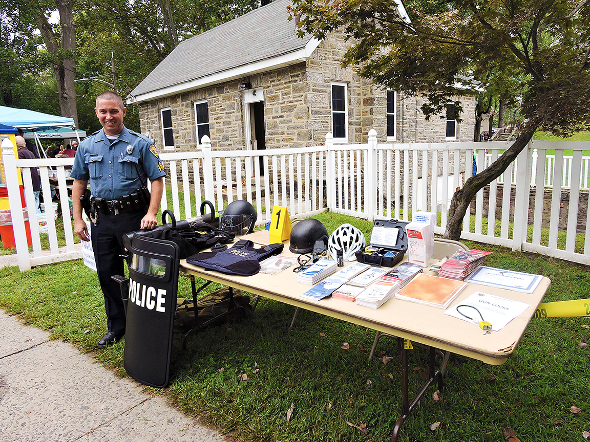 Glenolden officer Eric Gensemer distributed safety materials during Community Day.