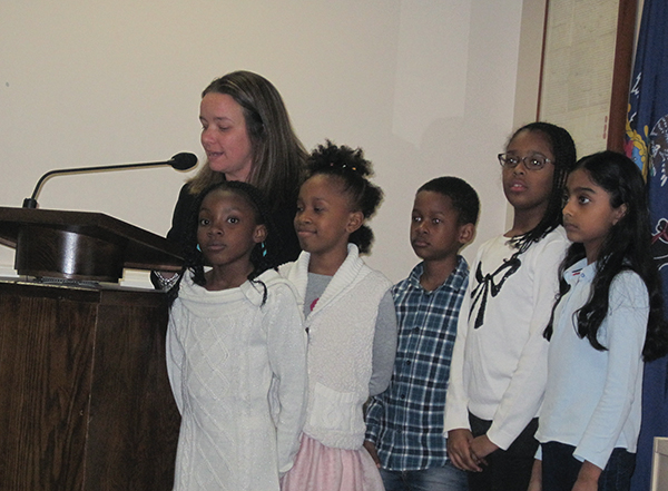 Charles Kelly Elementary School lead teacher Kelly Udovich accompanied by Kelly School student ambassadors, spoke about the school's projects promoting kindness.