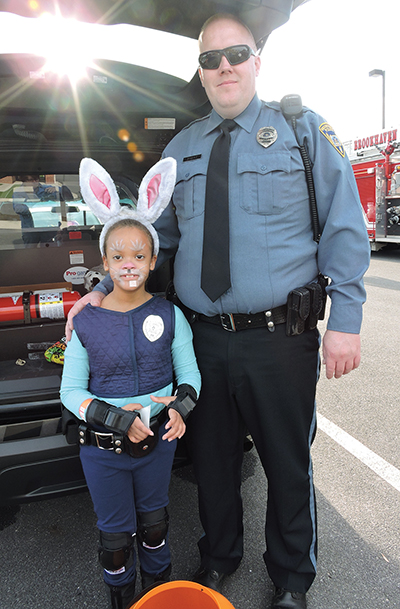 Brookhaven police officer Jonathan Zebley with his daughter, Ryan.