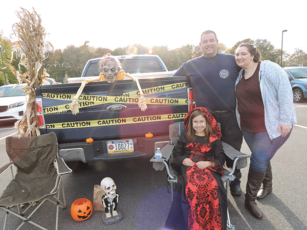 John, Shana and Haley Ellmore had a great time at the Trunk or Treat.