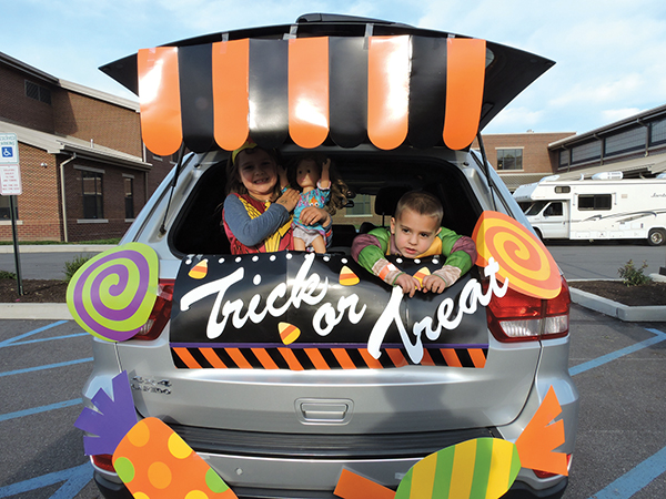 """Trick or Treat!"" said Sophie and Billy Messick from the back of their parents' car."