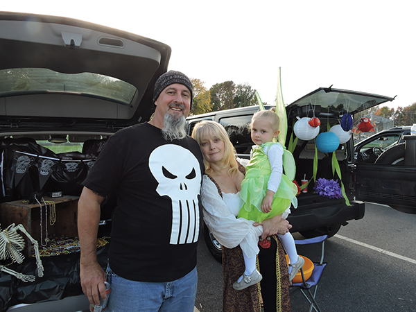 Mike and Janice Garvey, who organized the Trunk or Treat event, had a great time with their little granddaughter, Madison.