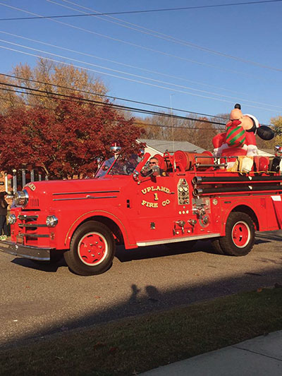 A vintage Upland fire truck was a crowd pleaser in the Brookhaven holiday parade.