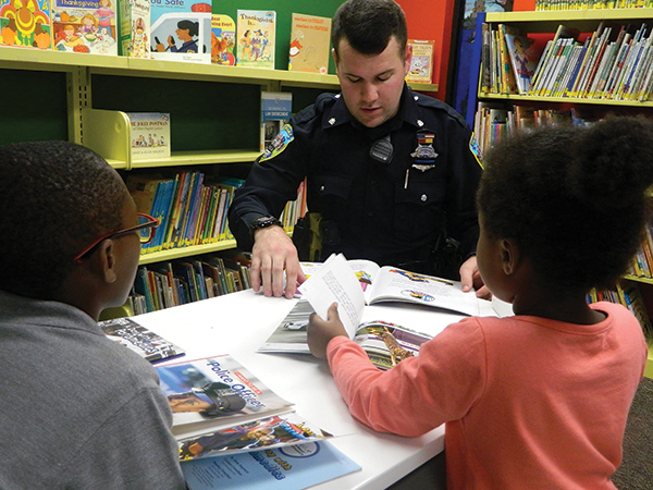 Cops and kids bond over books