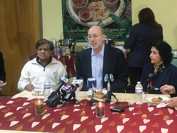 Gov. Tom Wolf (center), who said he and his wife only eat Jyoti rice, enjoyed an early lunch with the owners, Vijai (left) and Jyoti Gupta, as a gaggle of media people covering the event looked on.The company was named in honor of the wife.