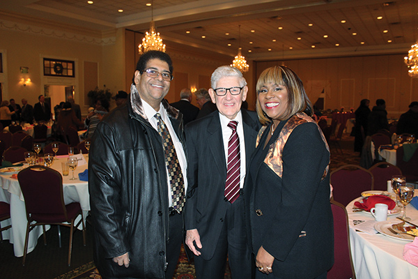 "County Recorder of Deeds Tom Judge, Sr. (center) thought he was making an introduction when he was pleasantly surprised to learn that keynote speaker Renee Amoore (right) and The Spirit's publisher, Paul A. Bennett (left), were old friends ""from way back."" The pair was among the area's notables to appear as regular panelists on Sunday TV talk show, ""Inside Story,"" among other things. Jeanne Bennett photos"