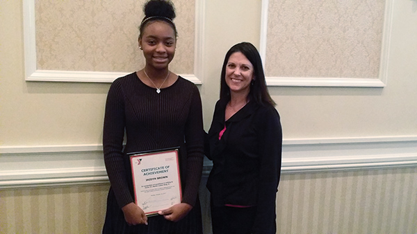 Jaiden Brown, winner of acertificate of achievement for her essay, with Cathy Brazunas, a teacher at Drexel Hill Middle School.
