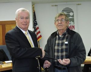 Aldan Council President Harry Short congratulates Town Watch President Herb Hays for the work it does in the borough.