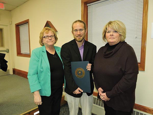 Aston Second Ward Commissioner Carol Graham (left) presents a proclamation to Aston Library Director Stephen Sarazin (center) and Delaware County Library Board member Maryann Bullen proclaiming April 10-16 as National Library Week.