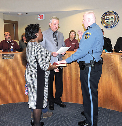 With his wife, Khyhisha, holding the Bible, Jonathan Zebley was sworn-in as a  full time police officer by Mayor Mike Hess.