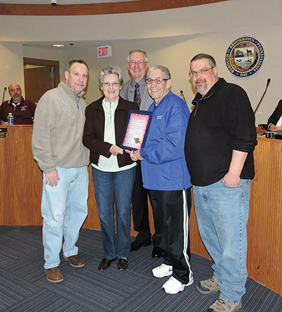Mayor Mike Hess presented a resolution to 50-year spouses Bruce and Julie Thomason. They were joined in the celebration by their sons, Bruce, Jr. and Greg.