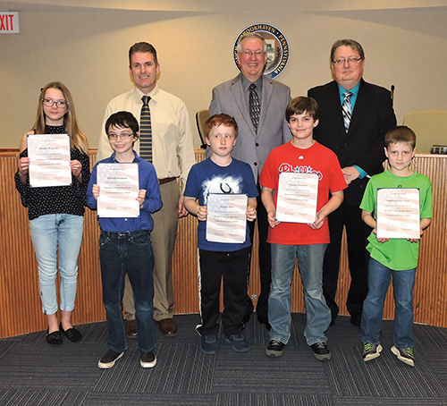 Coebourn Elementary School million word readers Maren McGinley, Dakotah Hermann, Stephen Shaw, Vincente Benchino and Anderson Stone were recognized by the Brookhaven Council. With the students are Coebourn Principal Eric Kumiga, Mayor Mike Hess and Council President John Wilwert, Jr.