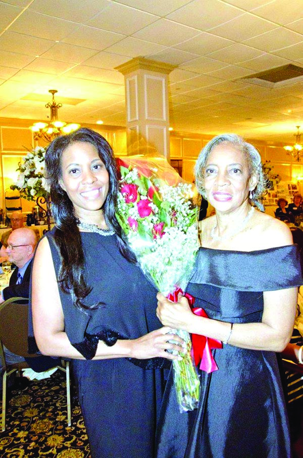 Rev. Bernice Warren's daughter, Kearni, gave her mother a bouquet of red roses.